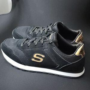 Skechers foam black with gold like new